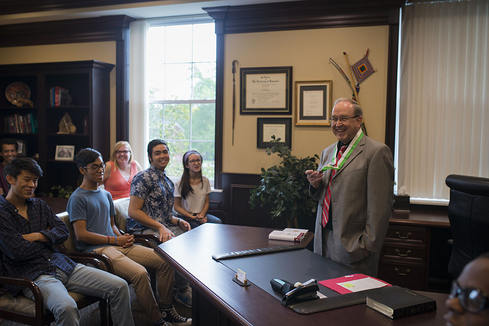 The Southern Scholars in president David Smith's office. President Smith is wearing an honors medallion